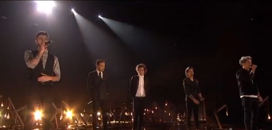 One Direction on stage at the 2013 AMA